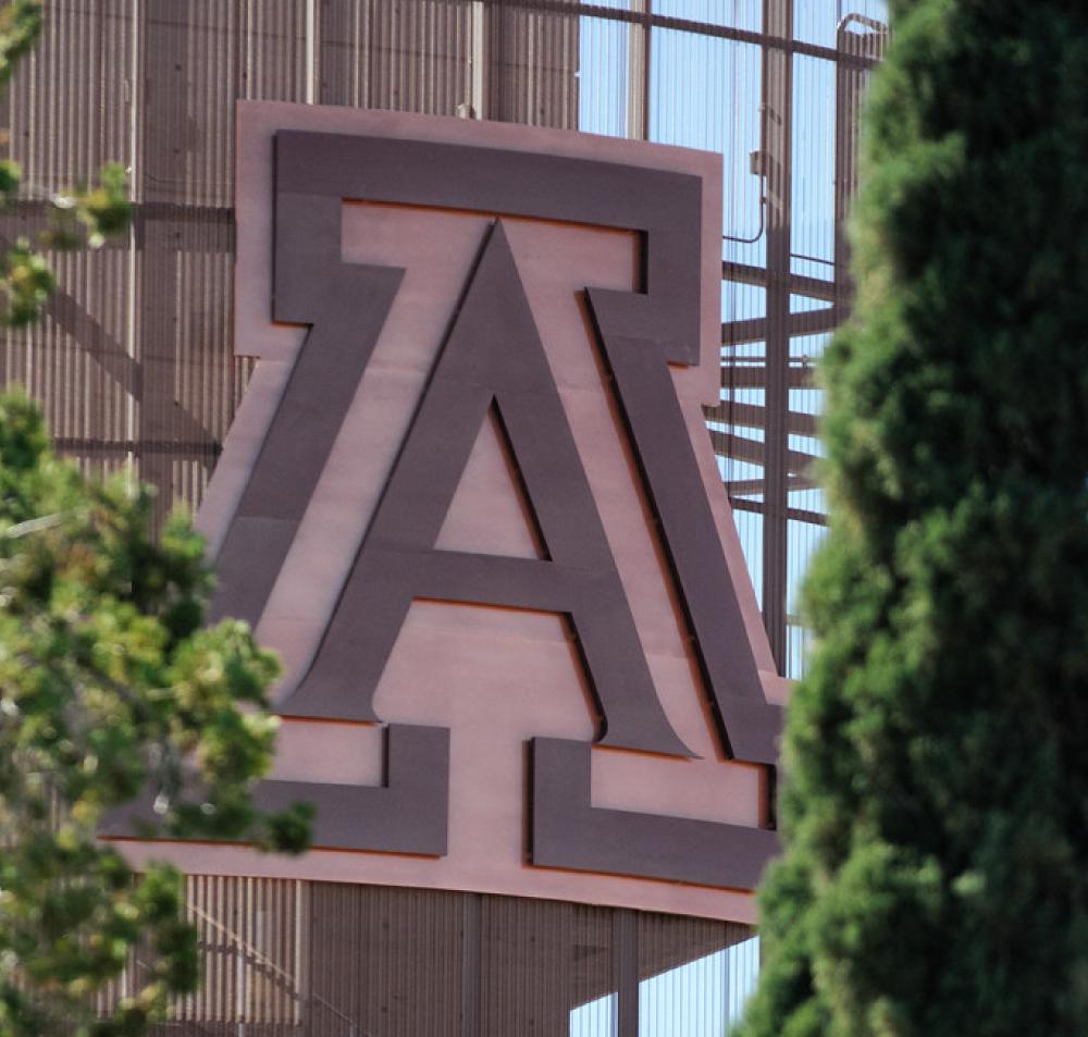 Photo of a large, copper Block A mounted atop Arizona Football Stadium
